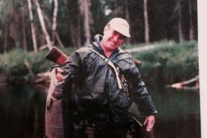 man in Alaska fishing